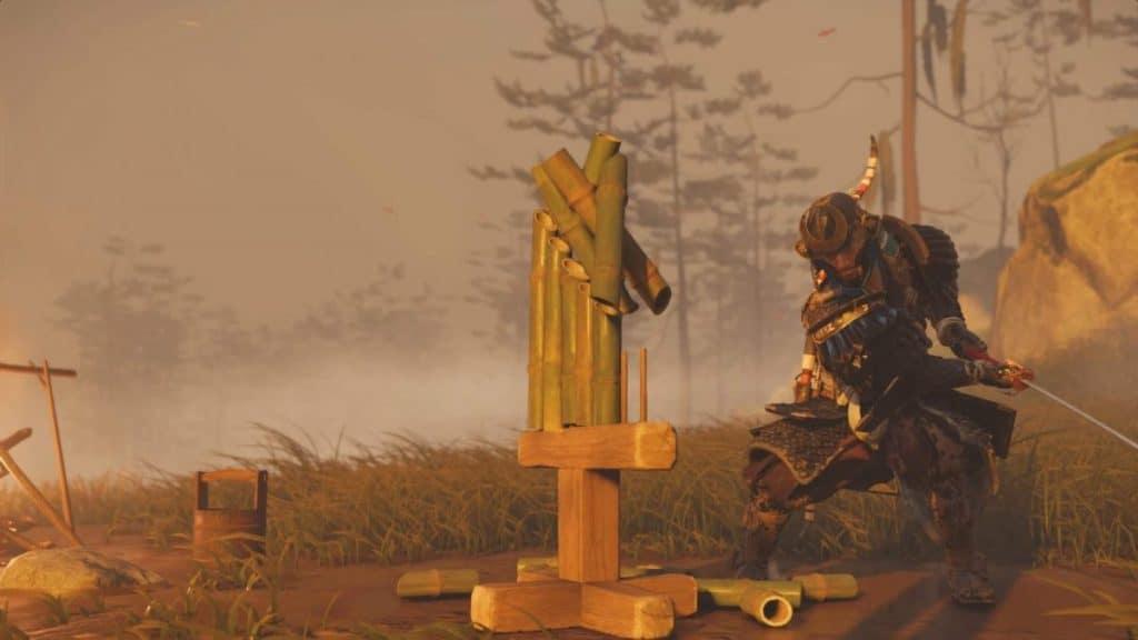 Jin spacca una postazione da spezza-bambù con la sua katana