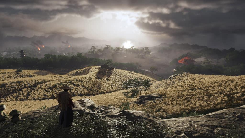 Jin guarda il sole sorgere mentre davanti a lui c'è un campo di grano