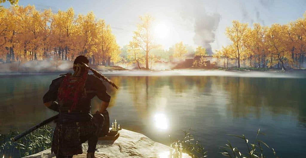 Jin siede osservando la natura mentre sorge il sole, davanti lui c'è un lago e diversi alberi con foglie arancioni