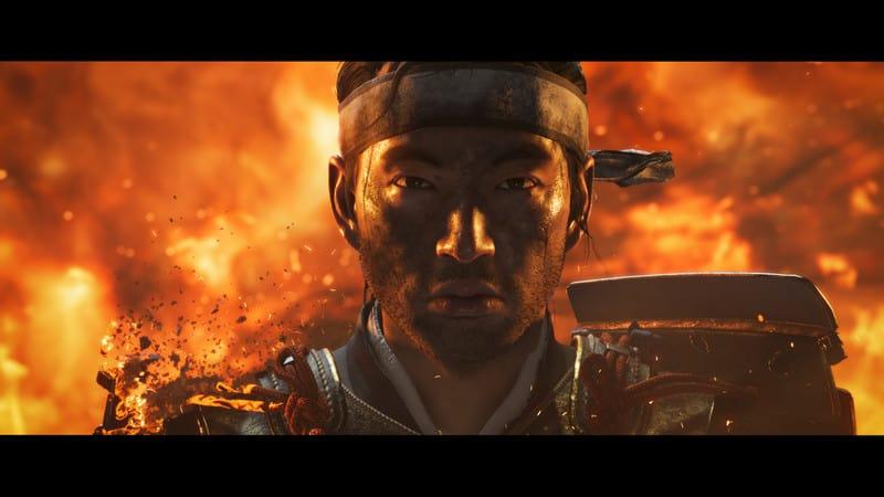 Jin circondato dalle fiamme in un'immagine promozionale di Ghost of Tsushima