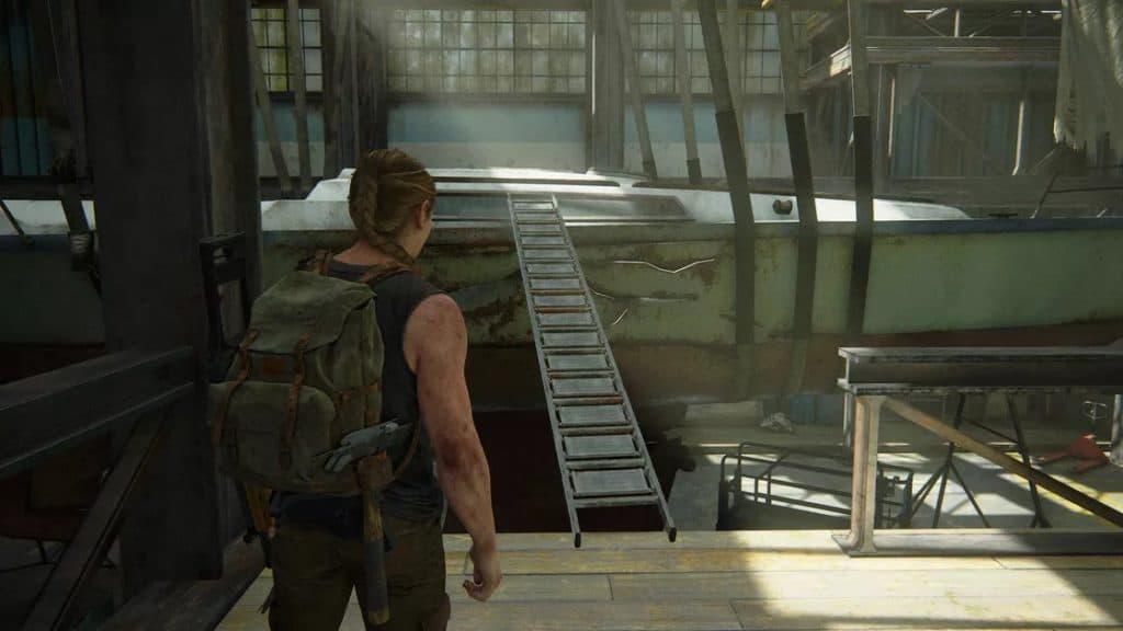 Abby si prepara a salire su una nave tramite un ponte che ha raccolto lì vicino