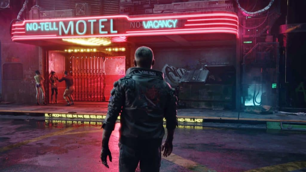 Il protagonista di Cyberpunk 2077 è davanti a un Motel illuminato a luci LED