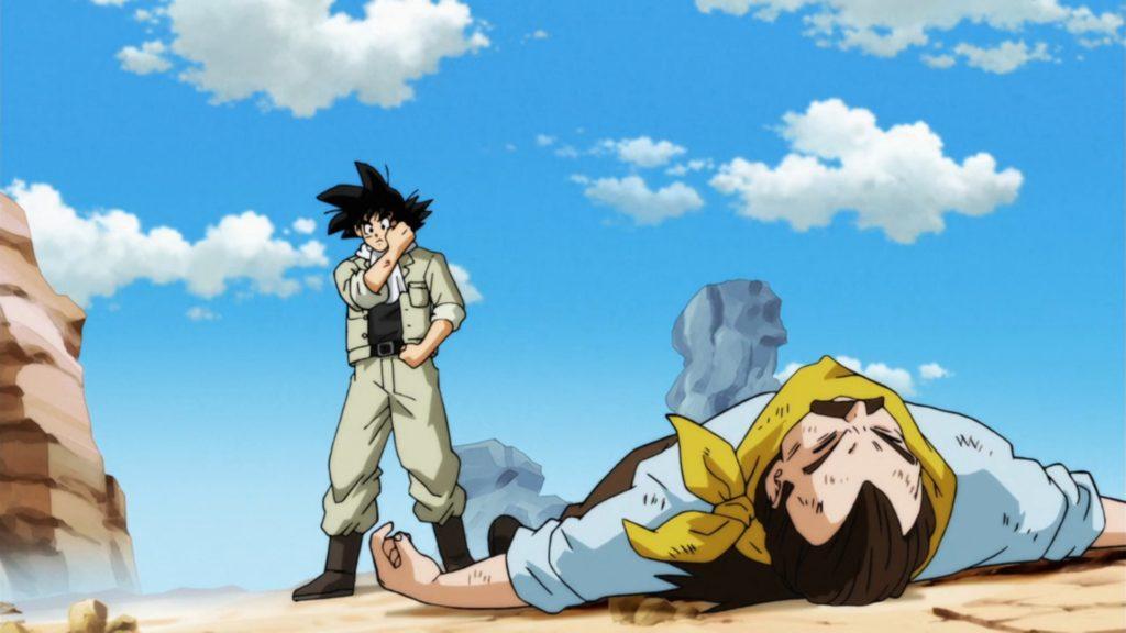 Son Goku alza un braccio per evitare un colpo di pistola di un rapinatore e rimane lievemente ferito