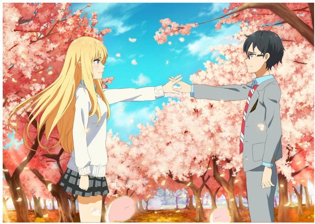 un ragazzo e una ragazza si stringono la mano in un parco pieni di ciliegi