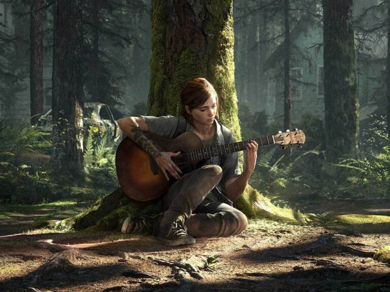 ellie suona la chitarra nel bosco
