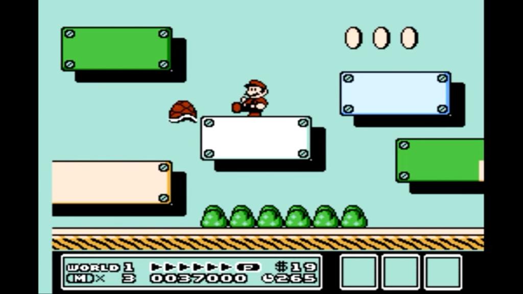 Mario colpisce un guscio rosso col piede mentre è sopra un blocco bianco