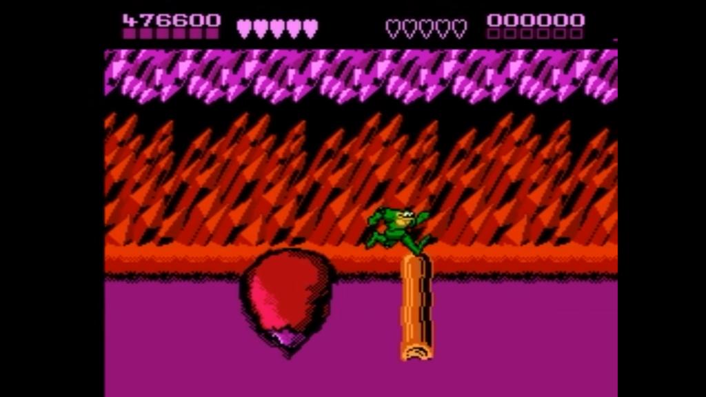 Il giocatore effettua un salto sopra un tronco per poter avanzare nel livello evitando di cadere nella pozza velenosa