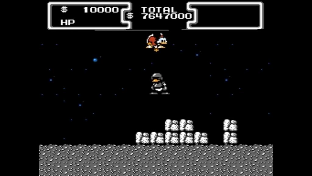 Paperone è sul livello della luna e salta sulla testa di un nemico armato del suo fantomatico bastone