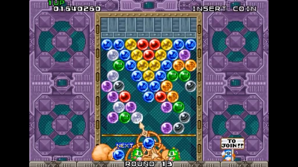 I draghetti devono riuscire a far cadere le bolle prima che scendano e sconfiggano il giocatore