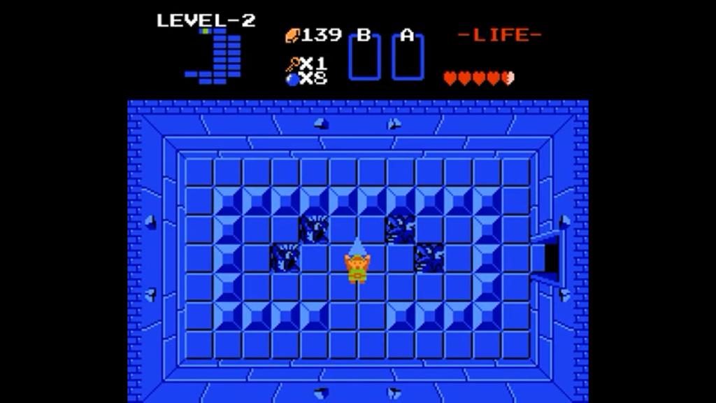 Link ha finito il secondo dungeon e raccoglie il frammento della Triforza alzandolo al cielo