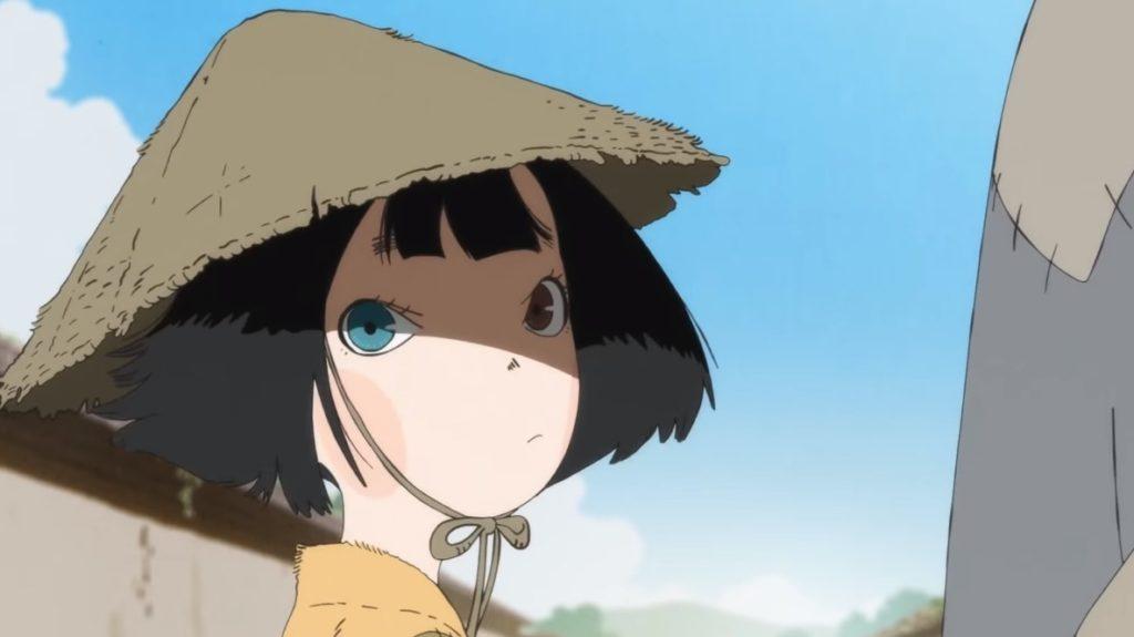 La protagonista con un cappello di bambù